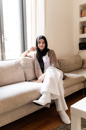 young muslim woman at home