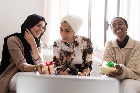 three young muslim women on video