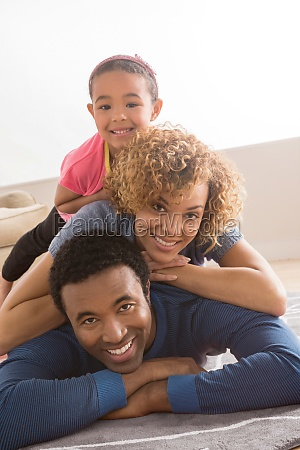 daughter on top of parents portrait