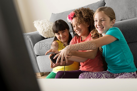 three girls playing video game