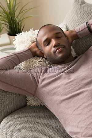mid adult man asleep on sofa
