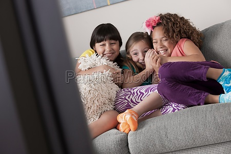 three girls watching tv