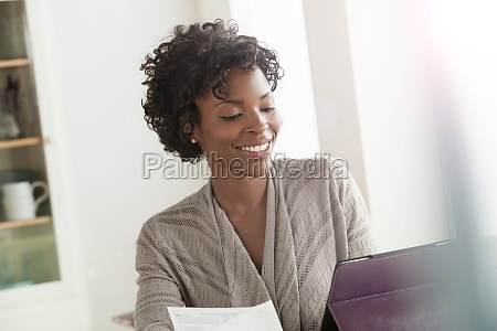 mid adult woman working from home