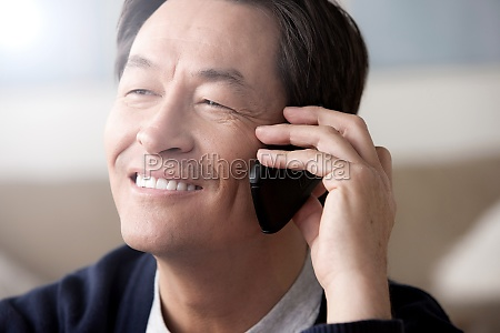 mature man on cell phone