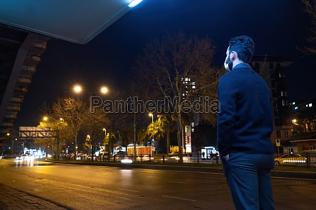a male standing in bus station