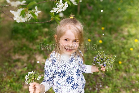 little girl with spring flowers on