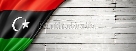 libyan flag on old white wall