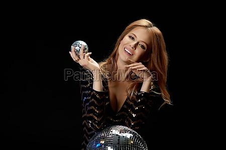 glamour model posing on near disco