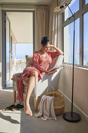 woman relaxing and reading book in