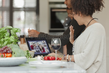 family cooking and video chatting with