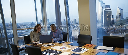business people working at laptop in