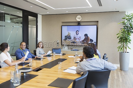 business people video conferencing in conference