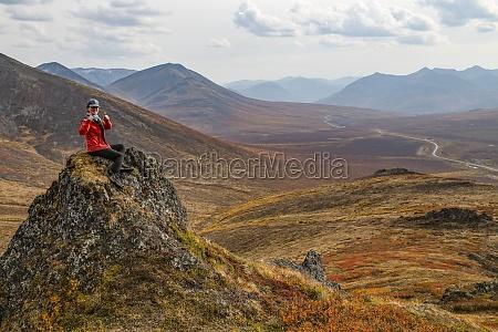 woman exploring the mountains along the