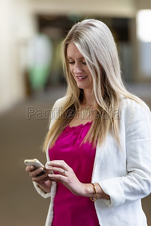 a professional mature business woman checking