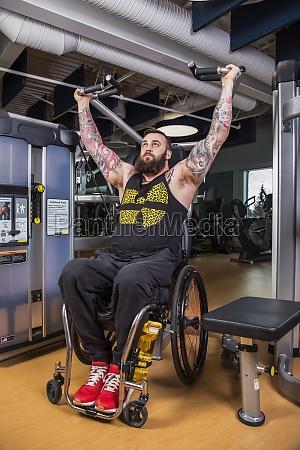 a paraplegic man working out using