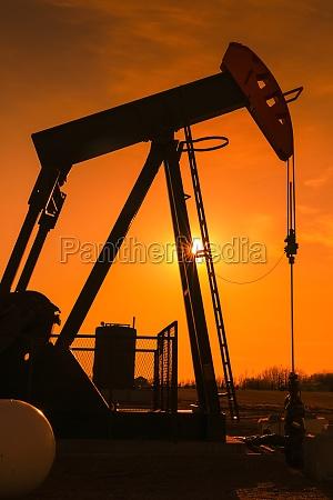 pumpjack at sunset alberta canada