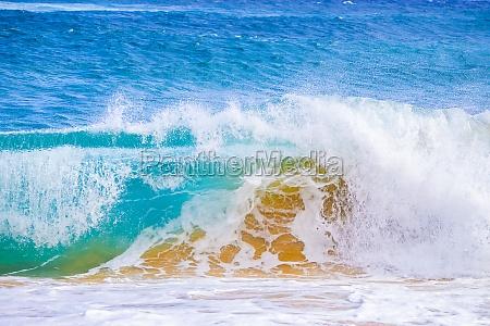 splashing waves along the shore of