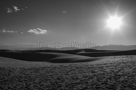 sun overhead the gypsum dunes of