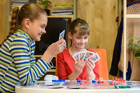 happy kids playing board games