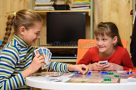 two girls joyfully laugh while playing