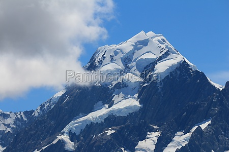 peak of mount cook and cloud