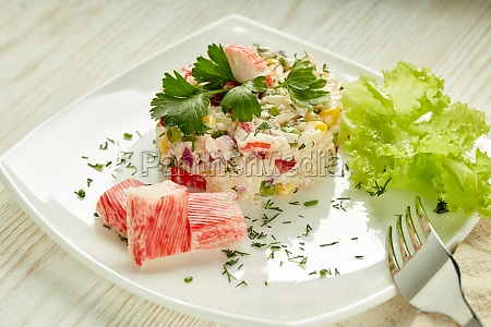 appetizing salad from crab sticks with