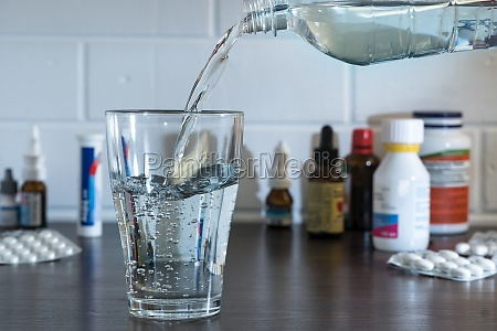 pour water into a glass against
