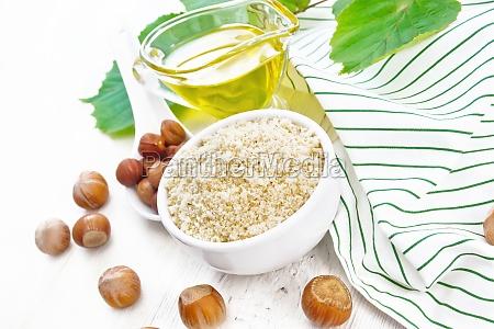 flour hazelnut in bowl on wooden