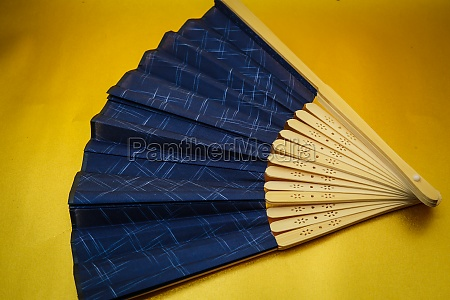 fan placed on the gold background