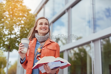woman student with books and coffee