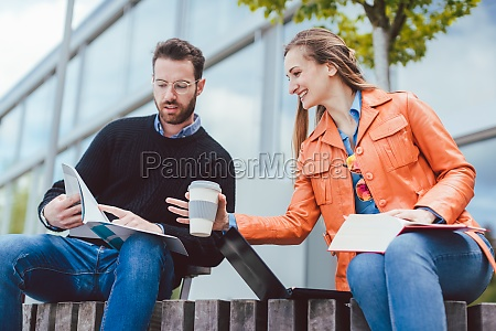 woman and man studying together on