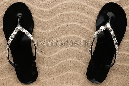 pair of black beach sandals in