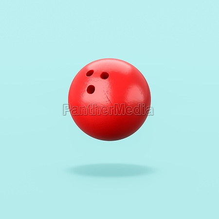 red bowling ball on blue background