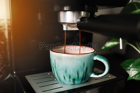 green cup of coffee at the