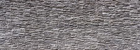 panoramic wall with cladding made of