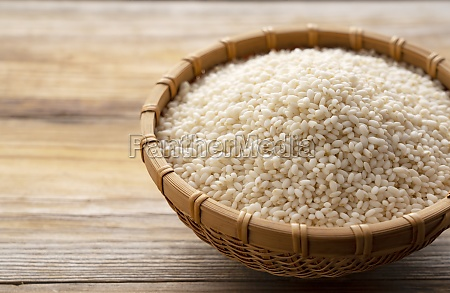 glutinous rice in a bamboo colander