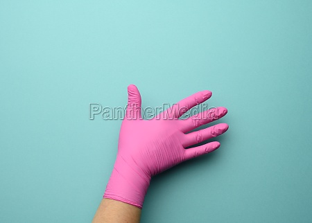 female hand in a pink latex
