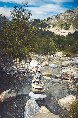 cairn on a river in vanoise