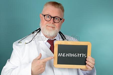 doctor holding blank chalkboard