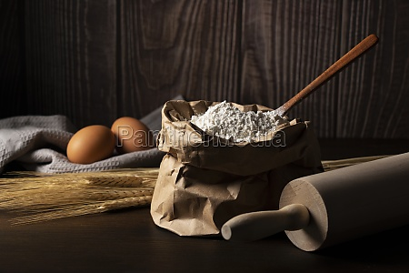flour set against a dark wooden