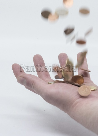 cash transaction hand with coins