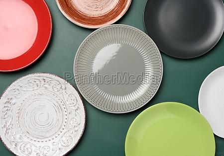 empty round multicolored ceramic plates on