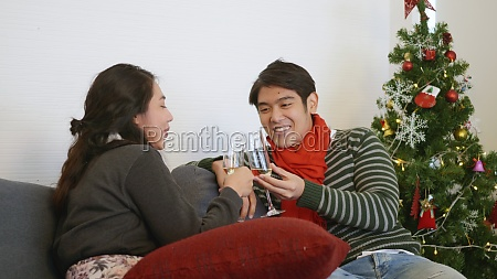 man and woman sit sofa in