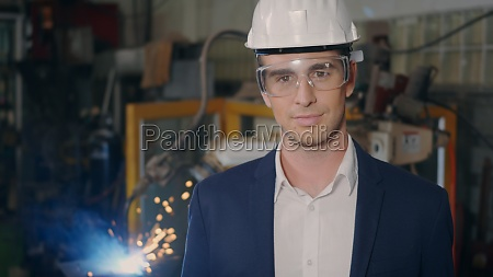 businessman in suits safety hats goggles