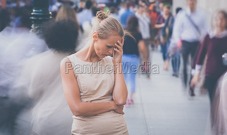 young woman standing still feeling
