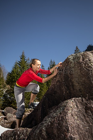 young female climber climbing on