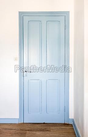 rustic blue door in a house