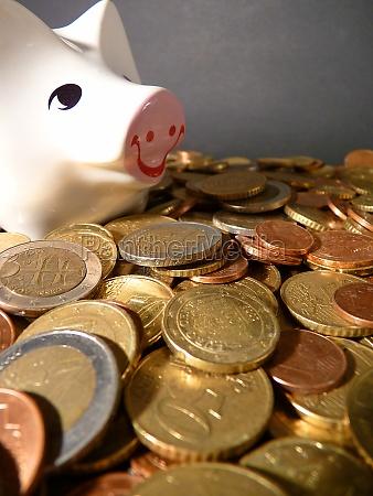 euro coins and a piggybank