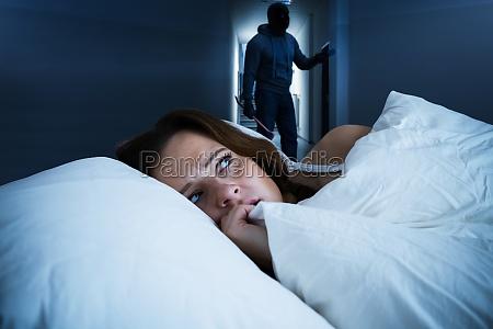 awake sleepless woman afraid and scared