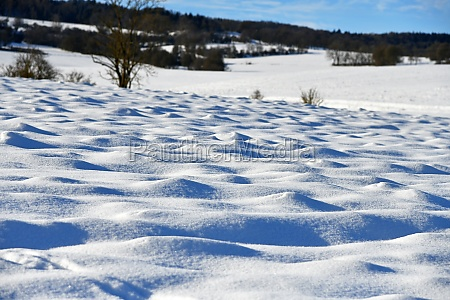 snow covered hilly arable land